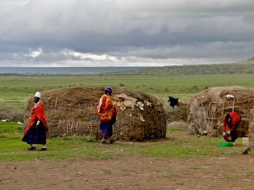 Masai in front of their homes